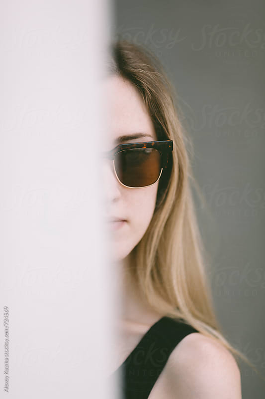 closeup of real young woman with sunglasses by Alexey Kuzma for Stocksy United