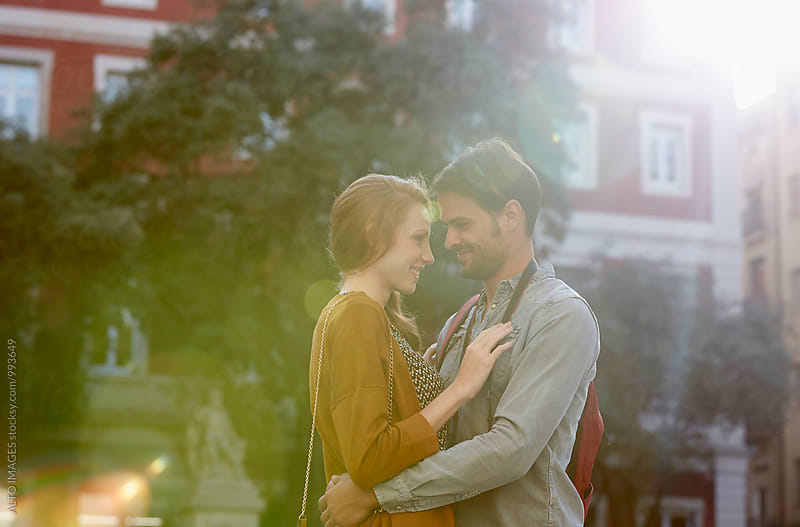 Romantic Couple Embracing In City On Sunny Day by ALTO IMAGES for Stocksy United
