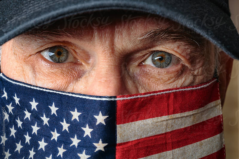 American flag as a face mask on a caucasian man by David Smart for Stocksy United