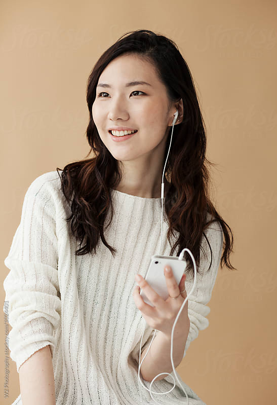 Asian woman talking on smart phone. by W2 Photography for Stocksy United