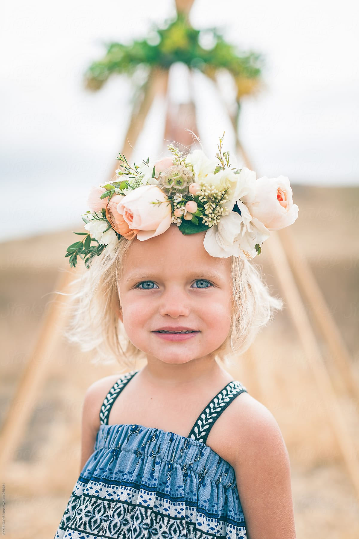 Portrait Of Young Girl With Flower Crown Stocksy United
