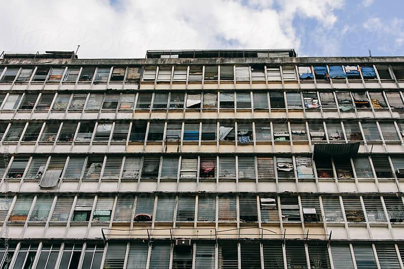 Old and poor building with windows on slums by Alejandro Moreno de Carlos for Stocksy United