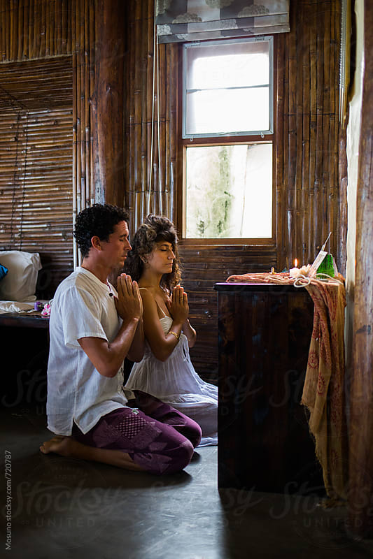 Couple Praying at the Altar at Home by Mosuno for Stocksy United