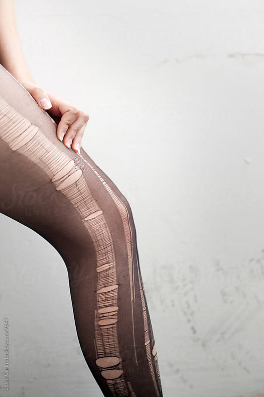 Stressed Woman Torn Pantyhose Detail by Eldad Carin for Stocksy United
