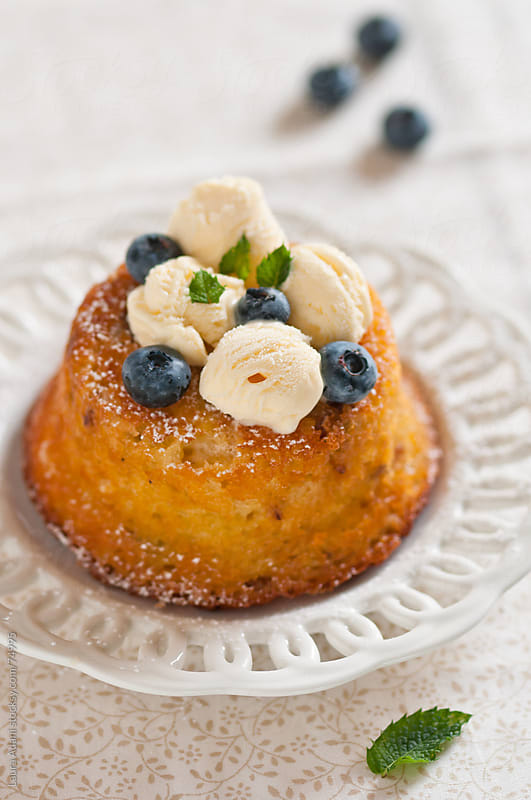 muffin with panettone and blueberries by Laura Adani for Stocksy United