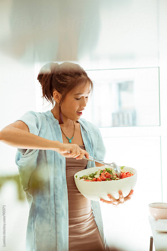 Woman Making a Salad by Lumina for Stocksy United