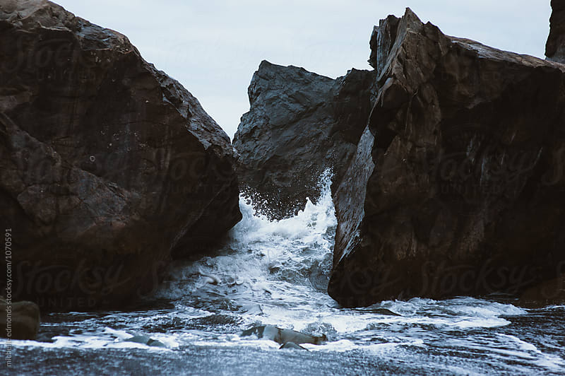 Waves Crashing on Boulders on the Shore of the Pacific Ocean in Washington by michelle edmonds for Stocksy United