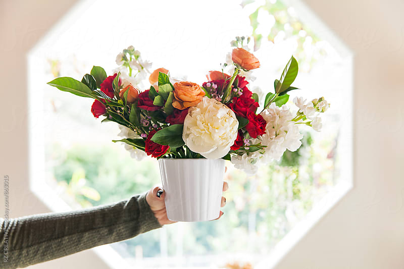 A colorful bouquet of flowers at home with bright natural light. by Robert Zaleski for Stocksy United