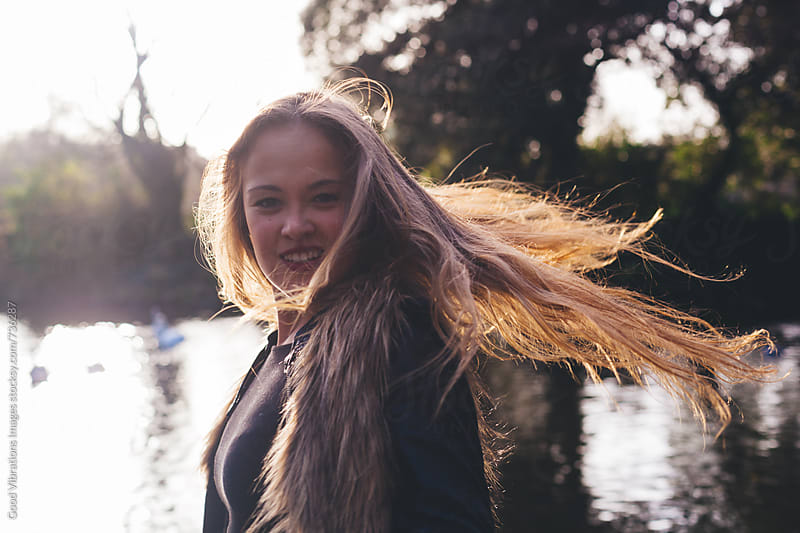 Young woman having fun by the river by Good Vibrations Images for Stocksy United