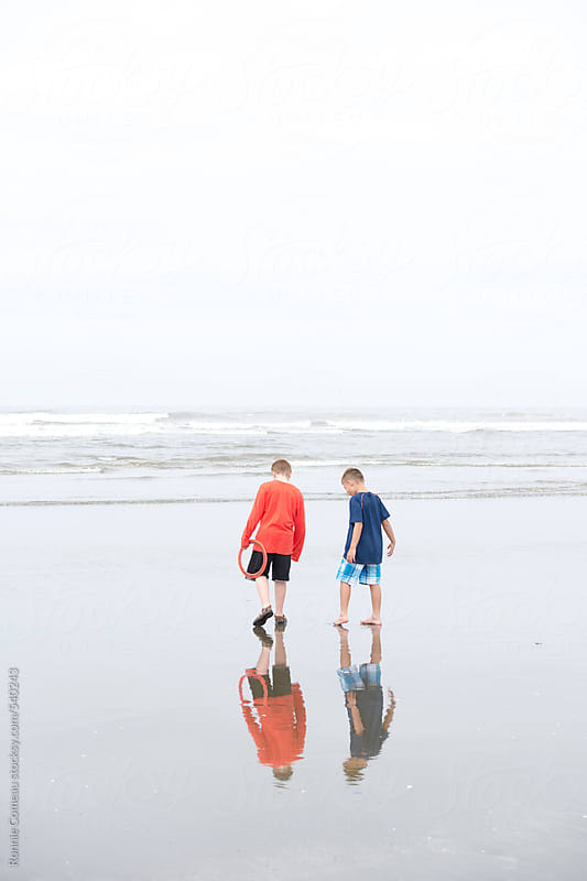 Boys At The Beach by Ronnie Comeau for Stocksy United
