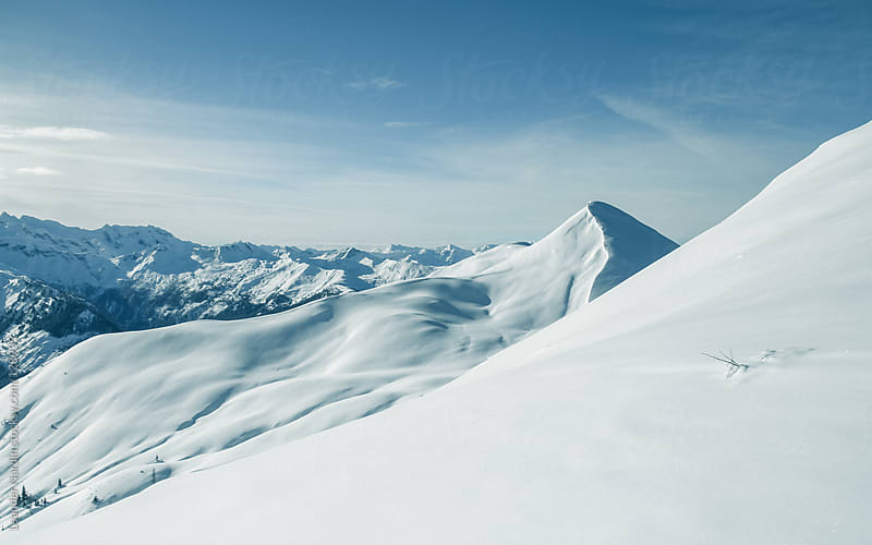 panorama view on snowcovered mountains by Leander Nardin for Stocksy United