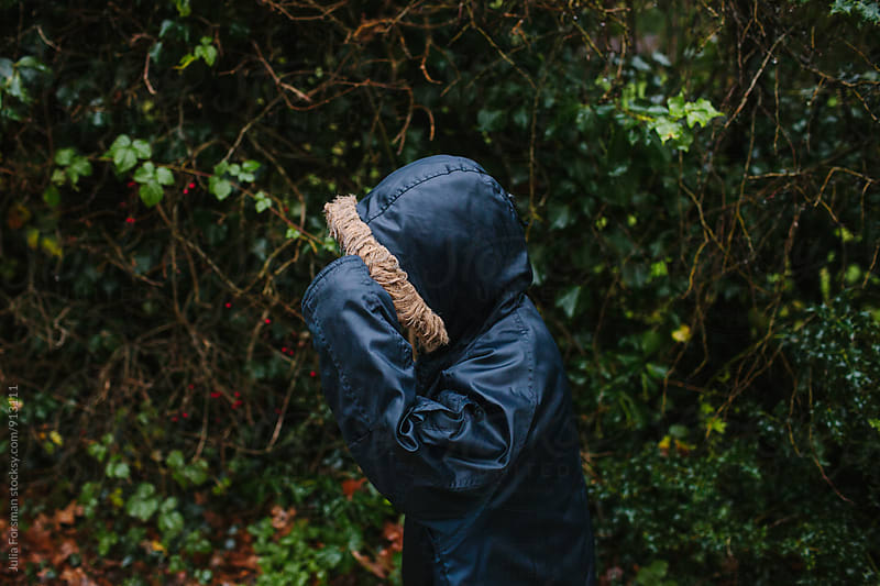 Anonymous child wearing hooded parka by Julia Forsman for Stocksy United