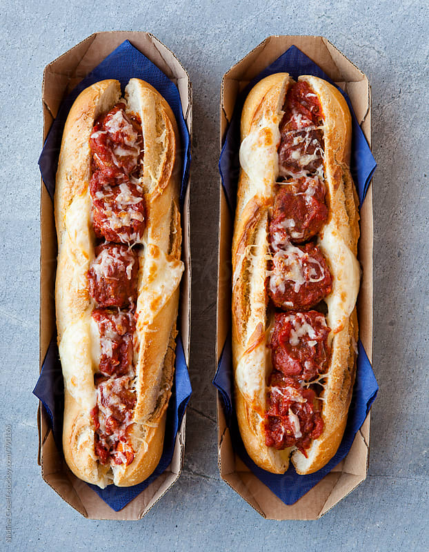 Meatball and cheese stuffed baguette rolls by Nadine Greeff for Stocksy United