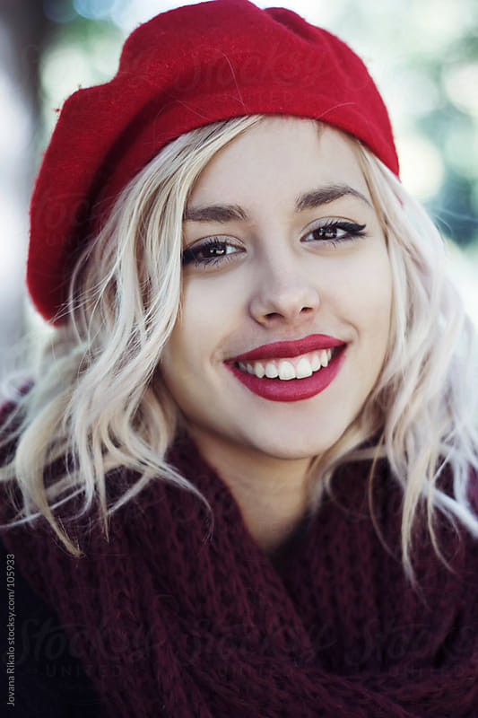 Portrait of a beautiful girl smiling by Jovana Rikalo for Stocksy United