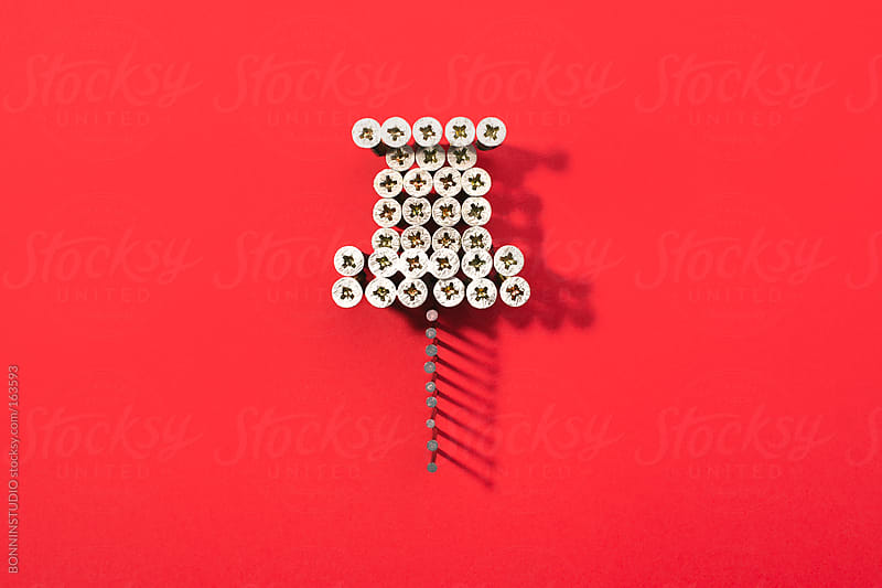 A pin shaped with lot of screws on red background. Social media icon. by BONNINSTUDIO for Stocksy United