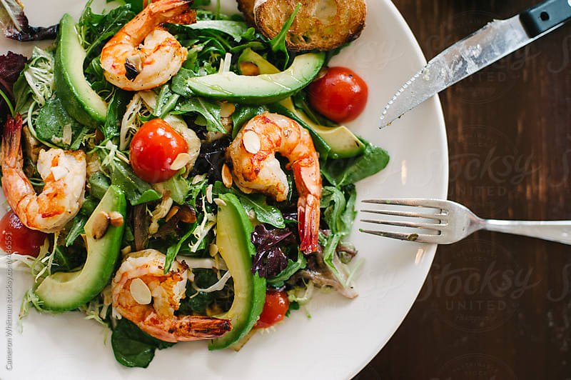 Grilled Shrimp and Avocado Salad by Cameron Whitman for Stocksy United