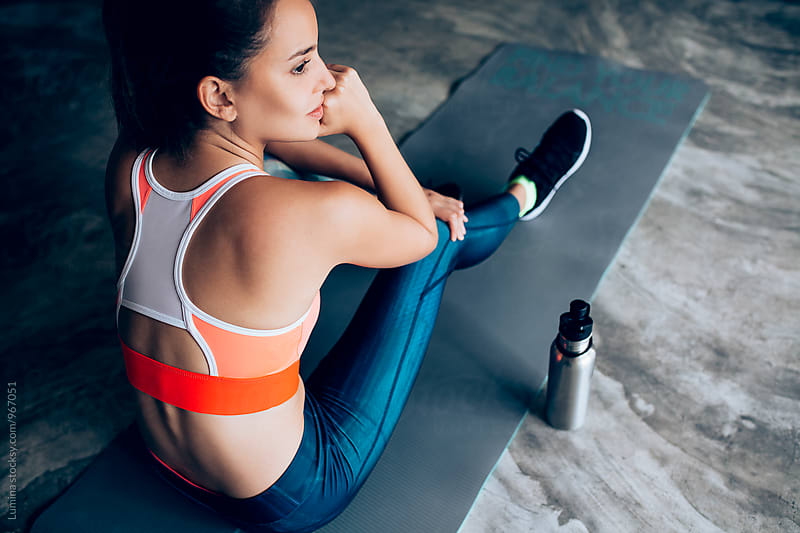 Woman in Sportswear Relaxing After a Workout by Lumina for Stocksy United