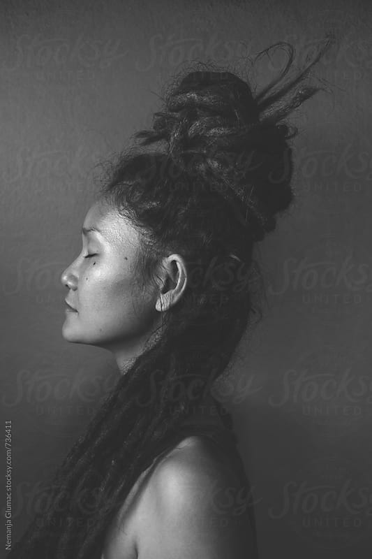 Authentic Thai Woman With Dreadlocks in Deep Meditation by Nemanja Glumac for Stocksy United