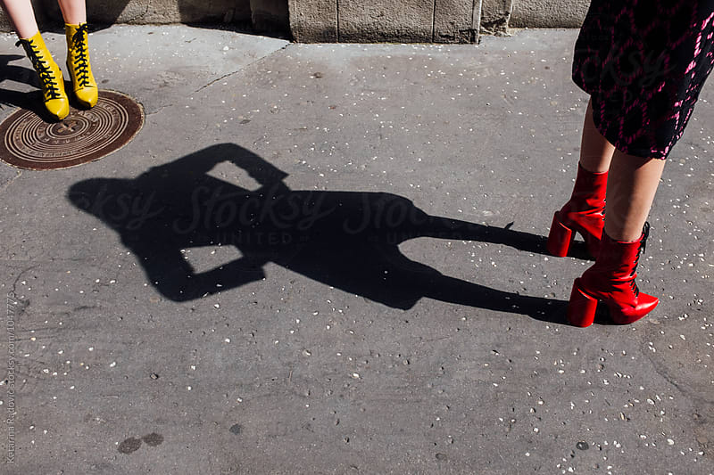 Female Model in Red Boots Standing on the Street  by Katarina Radovic for Stocksy United