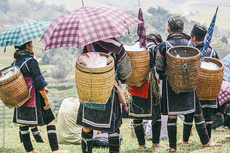 Group of women wearing traditional Hmong clothes in Sapa, Vietnam by Alejandro Moreno de Carlos for Stocksy United