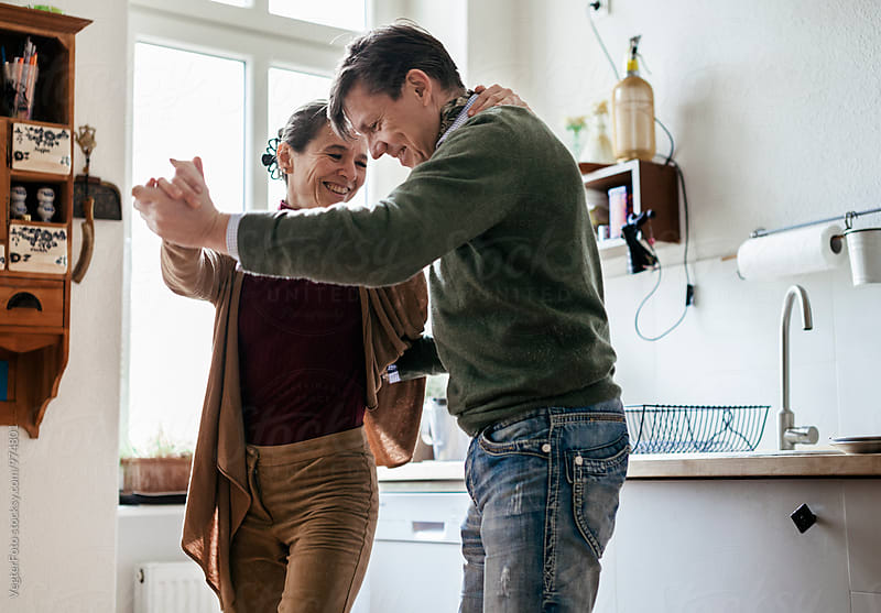 Mature Couple dancing by VegterFoto for Stocksy United