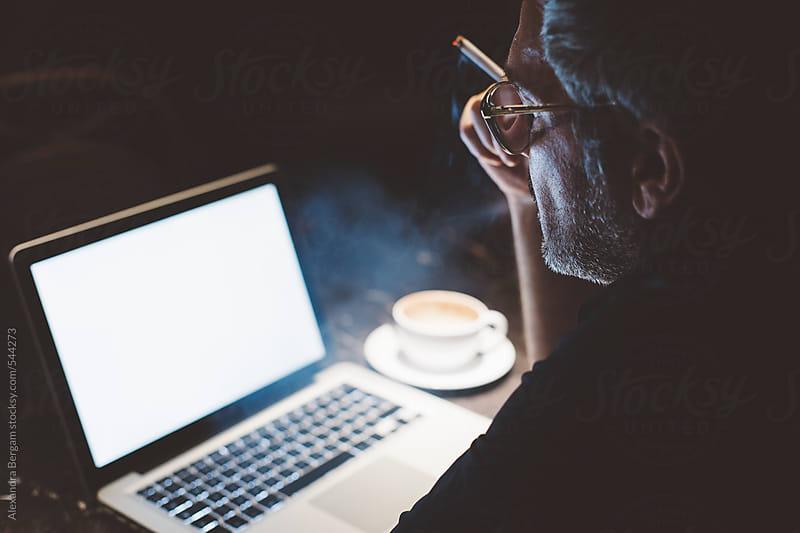 Man typing on laptop  by Aleksandra Kovac for Stocksy United