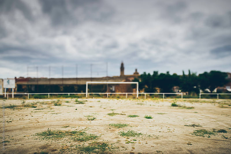 soccer goal in a small town by Javier Pardina for Stocksy United