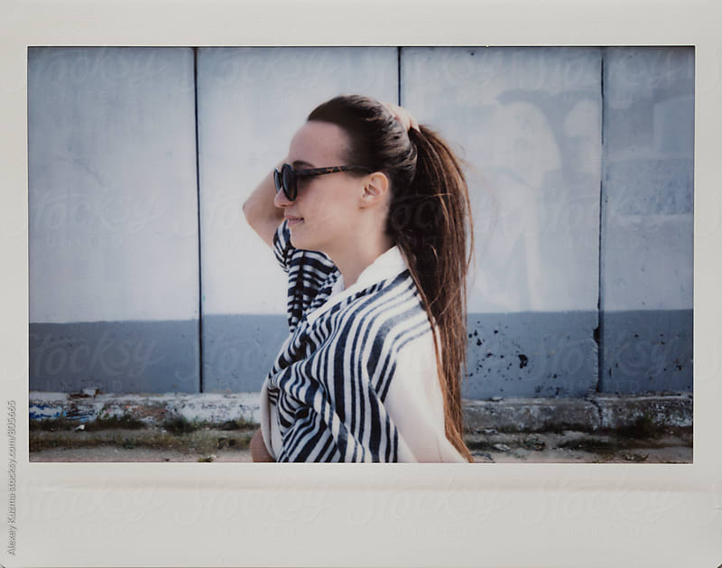 portrait of real young woman with round sunglasses. by Alexey Kuzma for Stocksy United