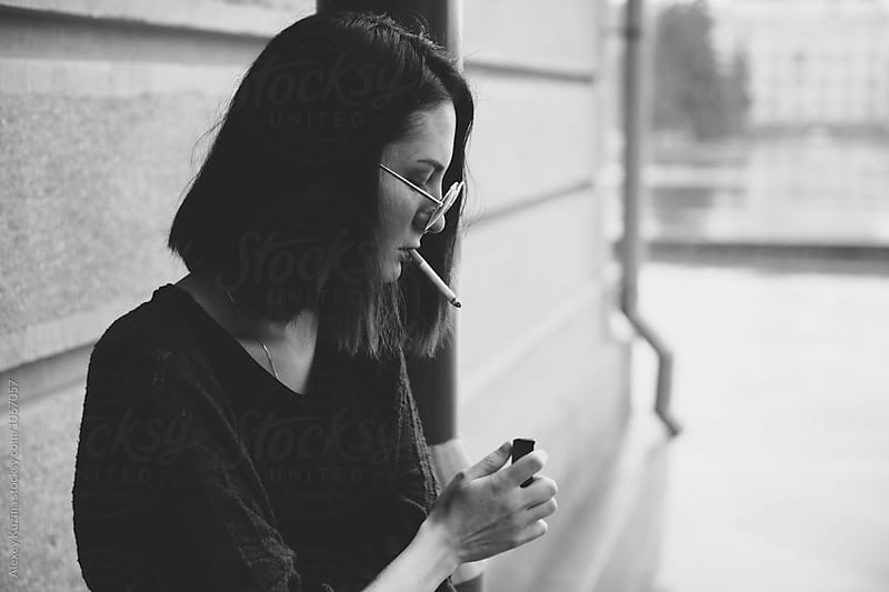 Portrait of the real young woman smoking  by Alexey Kuzma for Stocksy United