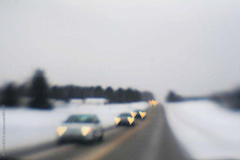 Heart Shaped Car Headlights On A Winter Road by ALICIA BOCK for Stocksy United