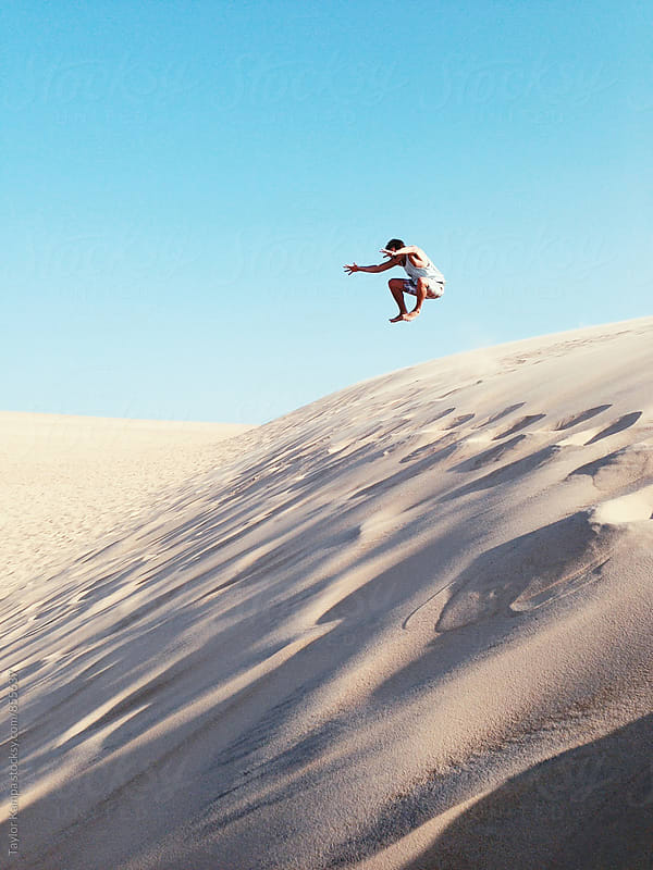 Sand Dune Jump by Taylor Kampa for Stocksy United