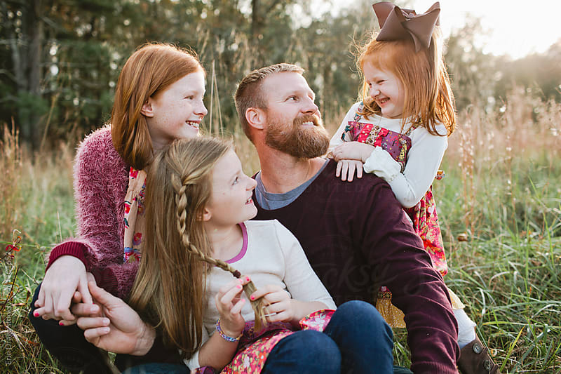 Dad with daughters by Erin Drago for Stocksy United