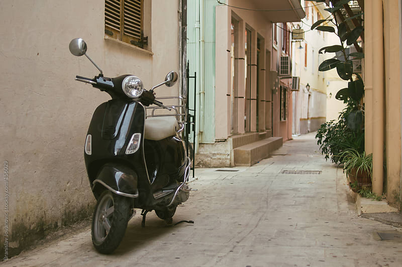 Black Italian scooter parked in the alley by Brkati Krokodil for Stocksy United