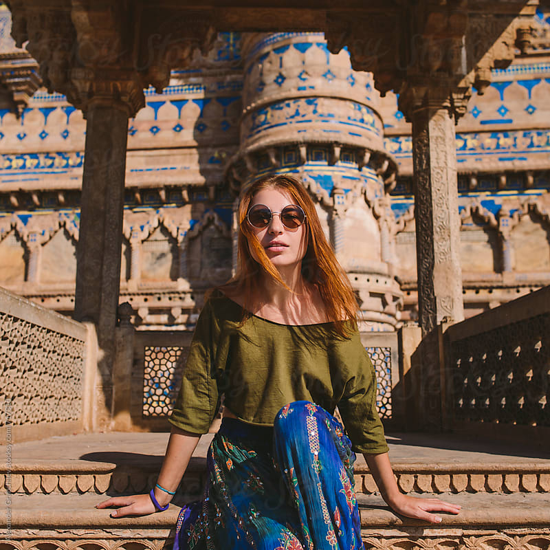 Redhead Woman Sitting In Indian Palace by Alexander Grabchilev for Stocksy United