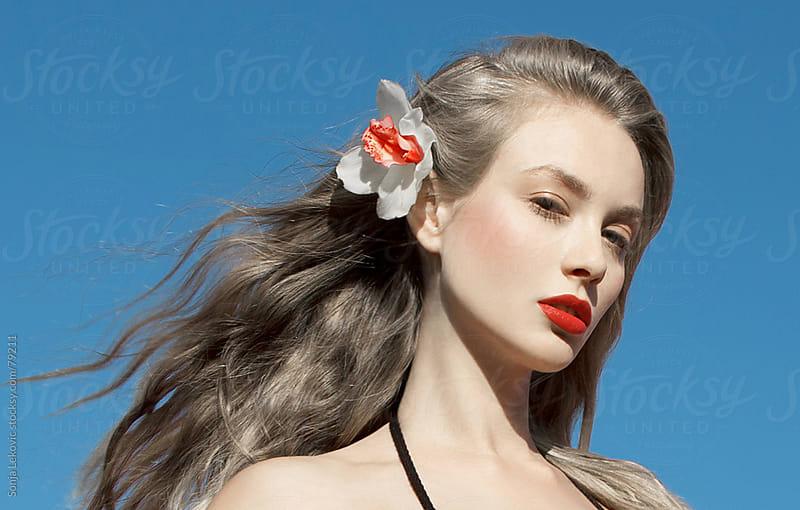 flower in the hair beauty by Sonja Lekovic for Stocksy United