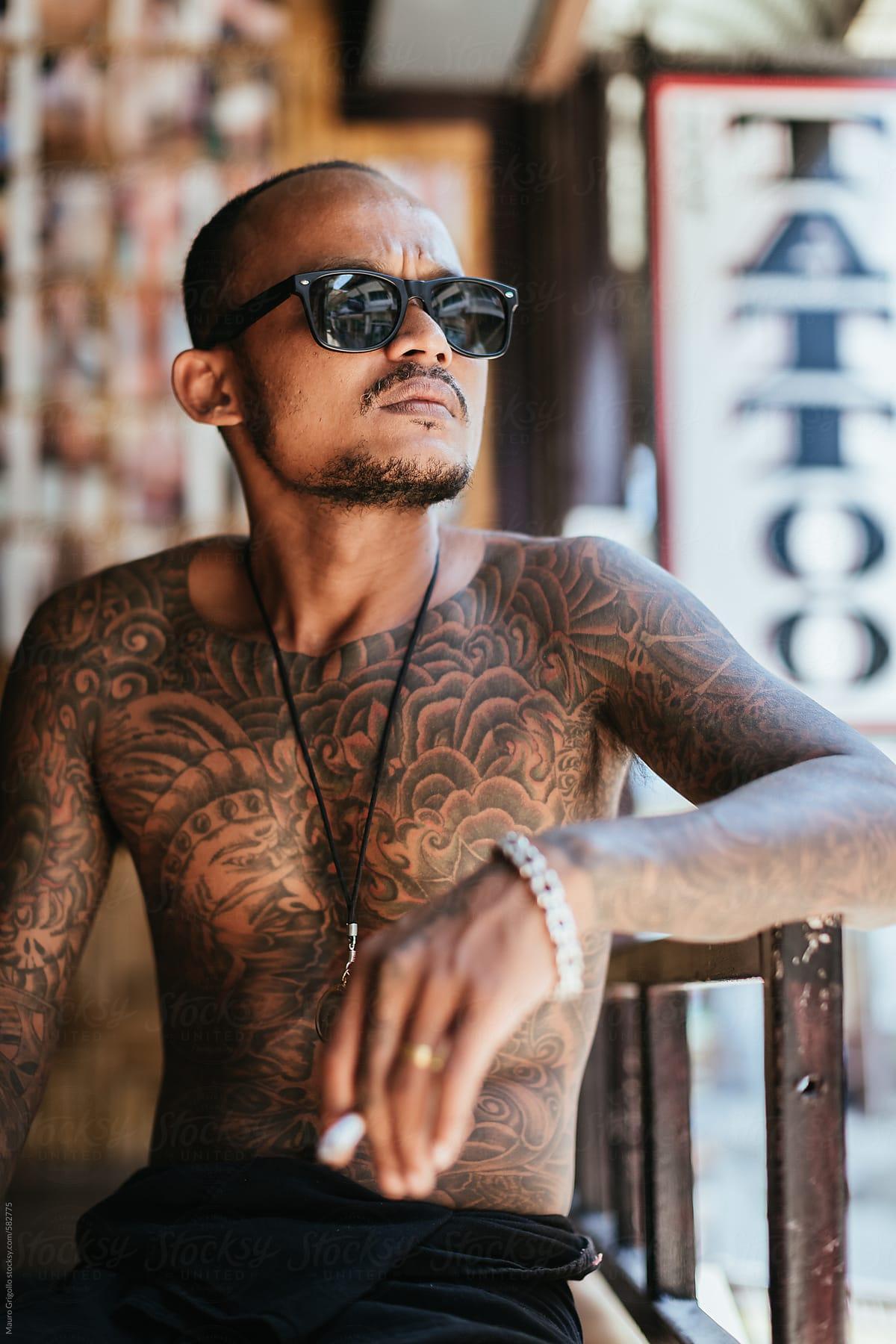 Thai Tattoo Artist Smoking A Cigarette During A Break By