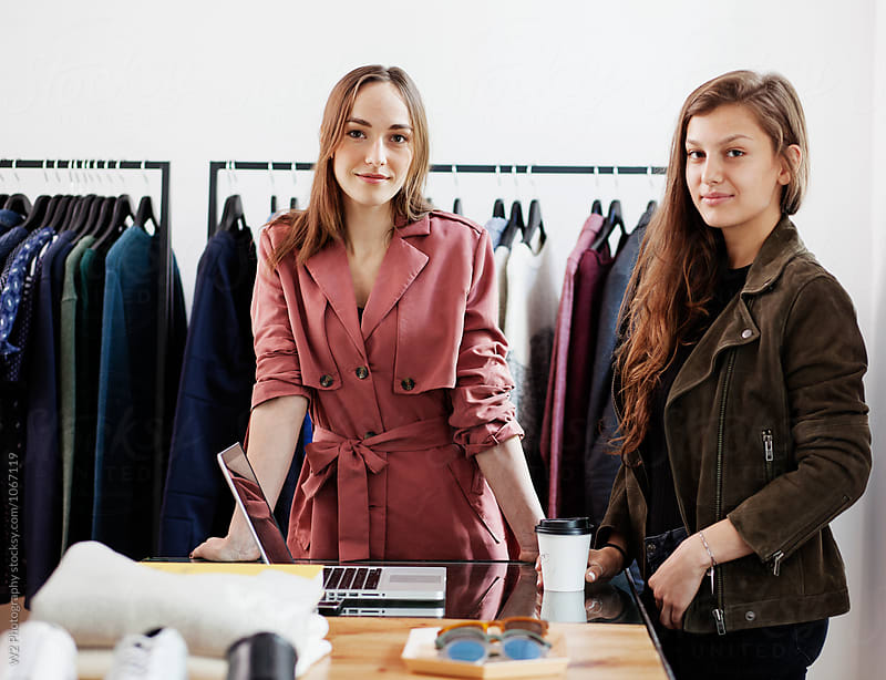 Portrait of business partners in a boutique. by W2 Photography for Stocksy United