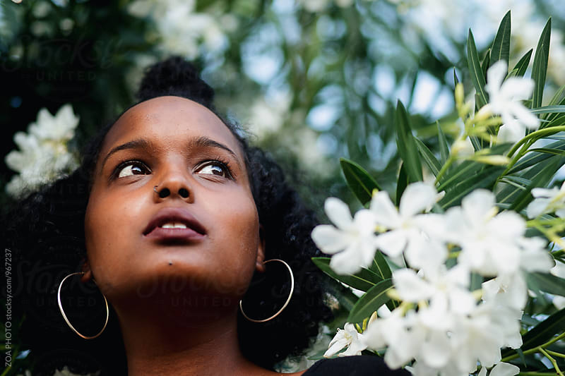 Spring time portraits of a young fun African American woman by ZOA PHOTO for Stocksy United