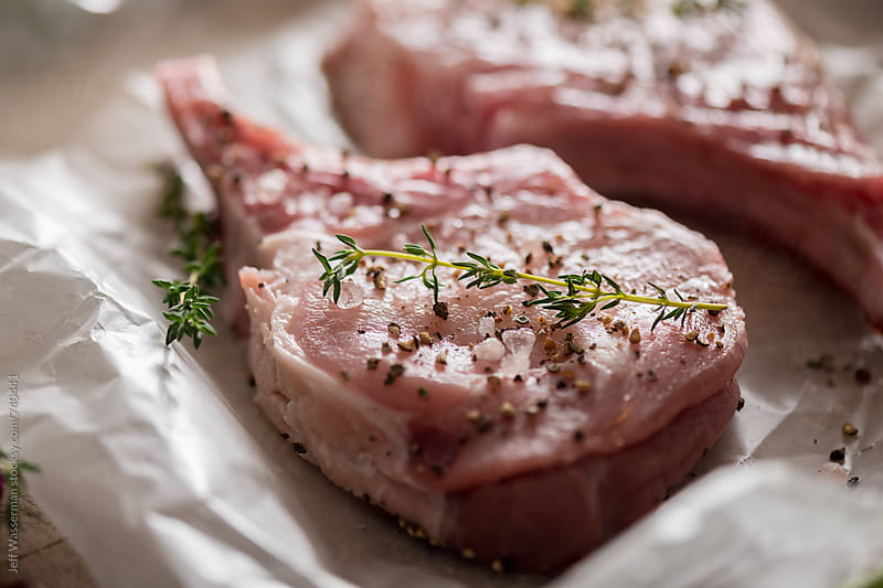 Raw Pork Chops with Thyme by Jeff Wasserman for Stocksy United