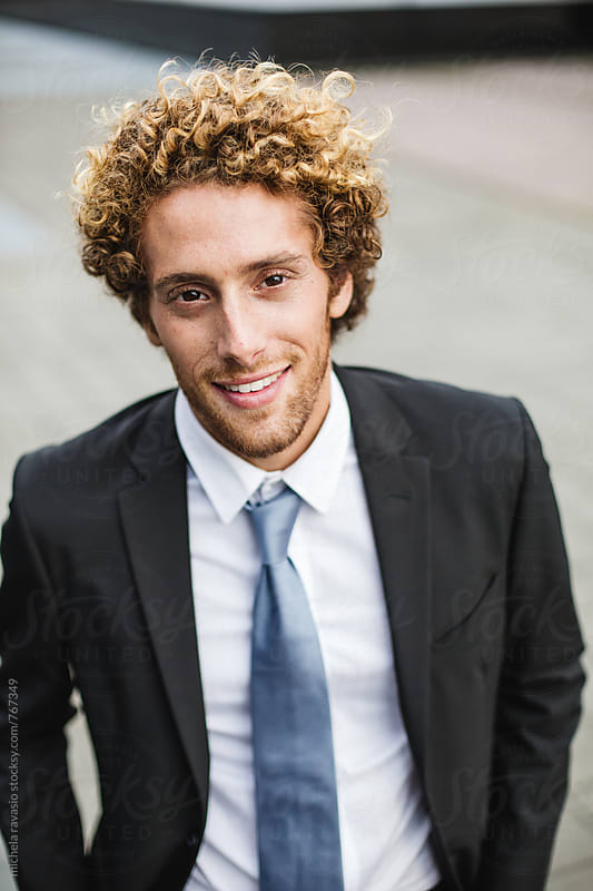 Portrait of an elegant handsome man by michela ravasio for Stocksy United