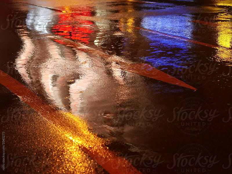Wet road after rain with traffic light reflection by rolfo for Stocksy United