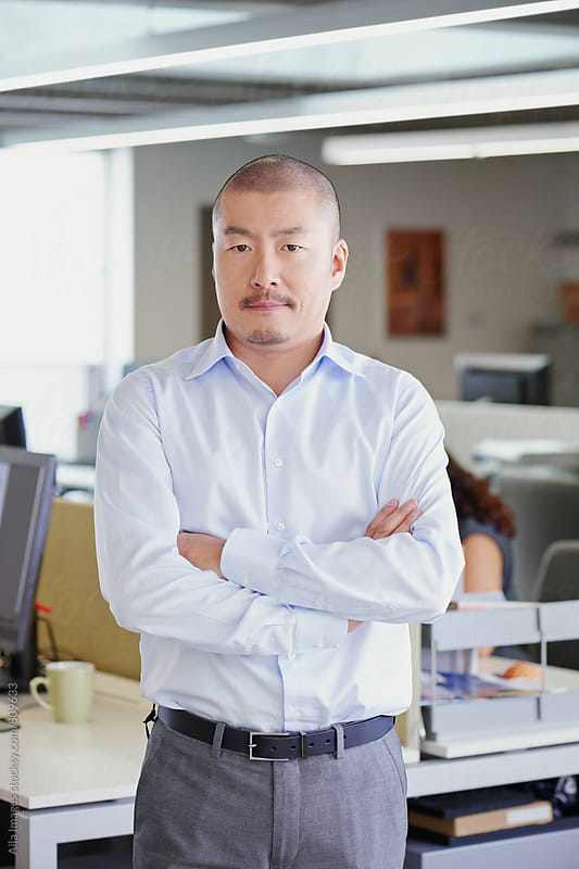 Portrait of Japanese businessman team leader entrepenuer in trendy office by Aila Images for Stocksy United