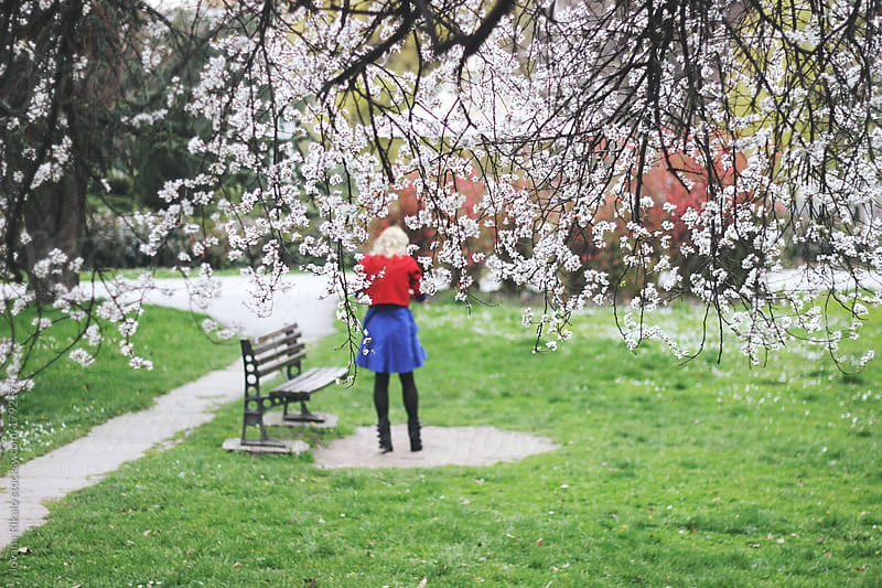 Young woman at park by Jovana Rikalo for Stocksy United