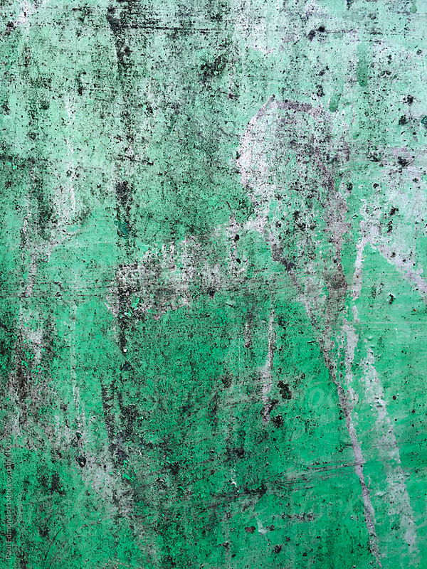 Close up of green peeling paint and graffiti on metal wall by Paul Edmondson for Stocksy United