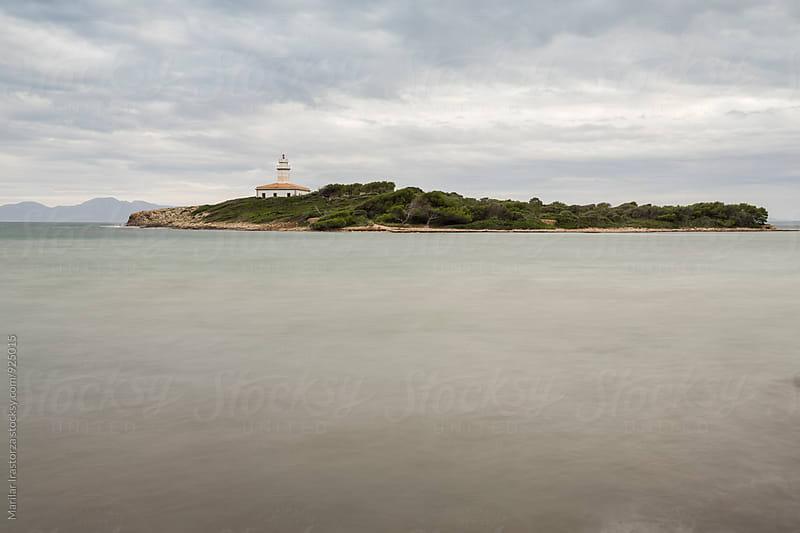 Lighthouse on a small island by Marilar Irastorza for Stocksy United