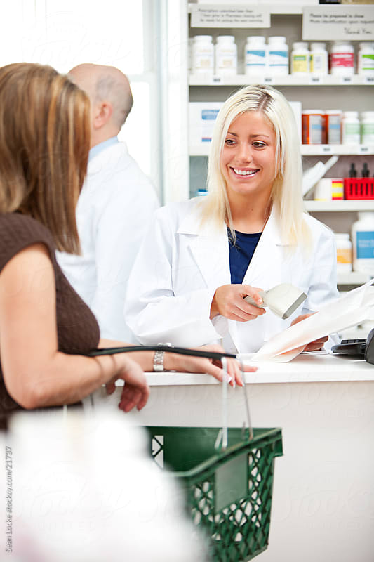 Pharmacy: Pharmacist Scans Customer's Prescription by Sean Locke for Stocksy United