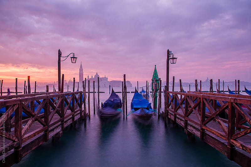 Gondola's in a Venetian sunrise by Chris Chabot for Stocksy United