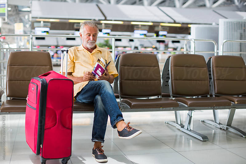 Man Sitting at the Airport by Mosuno for Stocksy United
