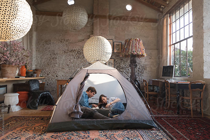 Couple Into Backpacking Tent into House by Mattia Pelizzari for Stocksy United