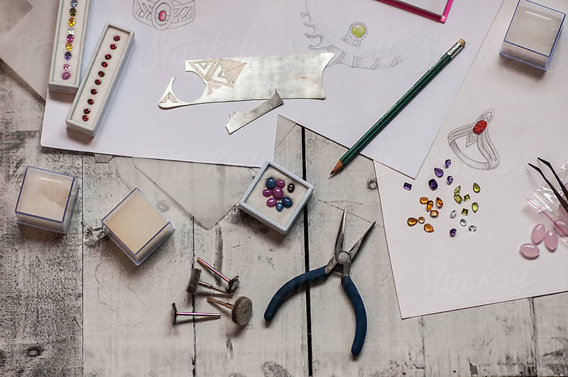 Jeweler's tools and  gemstones on the table by Aleksandra Jankovic for Stocksy United